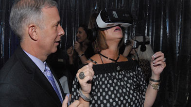 Robert Sclafani, left, and Jane Rabe, right, enjoy the virtual reality demonstration during the launch event of the new capital campaign at Lycoming College